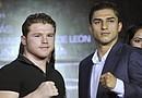 El mexicano Saúl Álvarez (i), campeón superwelter del Consejo Mundial de Boxeo, y el estadounidense Josesito López (d) posan hoy, martes 24 de julio de 2012, durante una rueda de prensa en Ciudad de México, para la promoción de su pelea del 15 de septiembre en Las Vegas, Nevada (Estados Unidos) en la función denominada 'Reyes del nocaut'.
