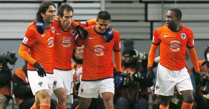 Jugadores del Monterrey festejan durante el partido que ganaron por 3-1 al Ulsan Hyundai surcoreano en su encuentro de cuartos de final del Mundial de Clubes, el domingo 9.