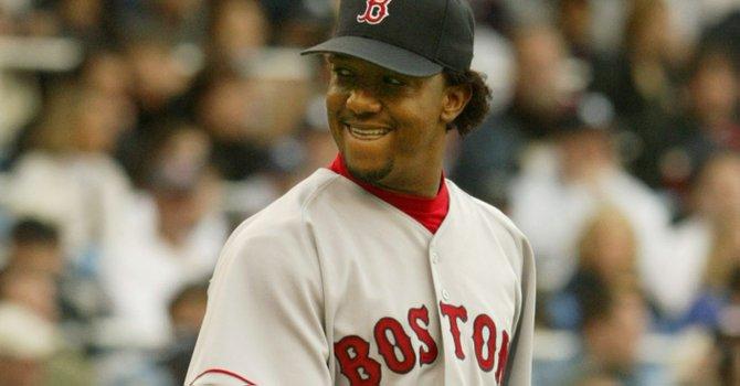 El ex lanzador dominicano Pedro Martínez tuvo unos años dorados con los Medias Rojas de Boston como parte de una gran carrera en Grandes Ligas que ahora lo lleva al Salón de la Fama.