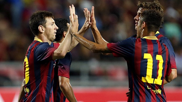 Lionel Messi (izq.) y Neymar (11) son las dos figuras de la delantera del Barcelona con las que el equipo español buscará quebrar la defensiva del Milan en el partido que jugarán por la Champions.