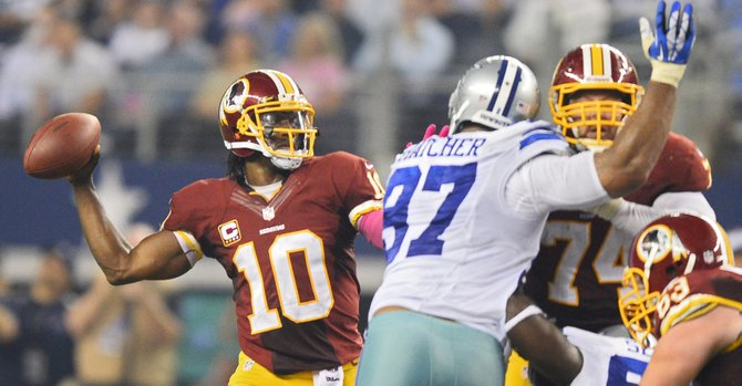 Cowboys propinan duro golpe a Redskins