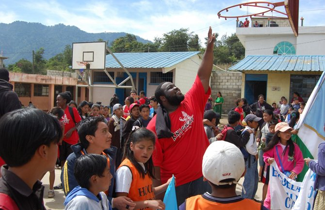 Jamal Coates, a member of the Hoops Sagrado team, reaches for the basket in the Guatemalan village of Pachaj. (Bryan Weaver)