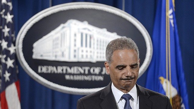 Fiscal general Eric Holder.
