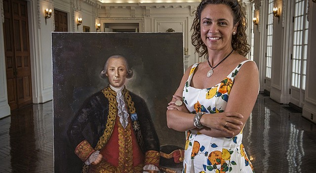 Teresa Valcarce, a.k.a. the Portrait Lady, with a painting of Bernardo de Galvez, a Spanish hero of the American Revolution, which she successfully fought to have mounted in the U.S. Capitol. (Bill O'Leary/The Washington Post)