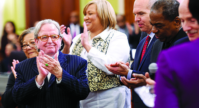 D.C. Council member Jim Graham (D-Ward 1) applauds during the closing ceremonies at his final city council meeting on December 17, 2014 in Washington. (Photo by Jonathan Newton / The Washington Post)