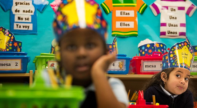 Ifunanya Okeye, left, and Darlin Salazar are seen in a Spanish immersion class at Cesar Chavez Elementary School in Hyattsville, Md.