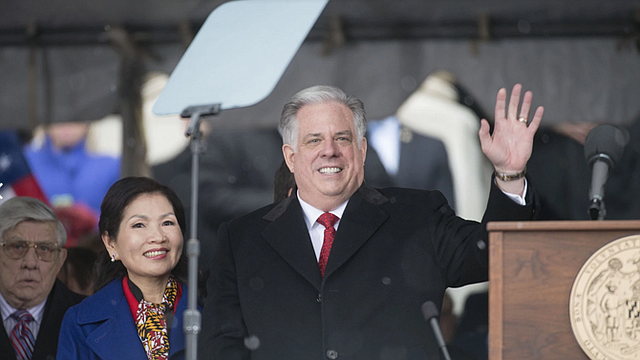 Hogan and wife, , Yumi, emerge from the state capitol after officially being sworn in.