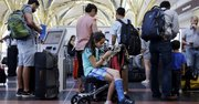 Aug. 15, 2015 After standing in line with for an hour and a half, Alisha Lalani, 10, of Ft. Lauderdale, Fla., looks at her phone as her mother and brother check in for their flight to Miami at Washington's Reagan National Airport.