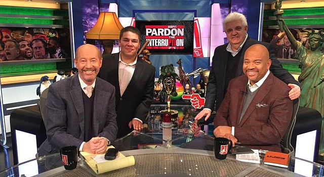 "Uriel Casas (back left) on the set of ESPN's ""Pardon the Interruption"" with Tony Kornheiser and Michael Wilbon. (Uriel Casas via The Washington Post)"