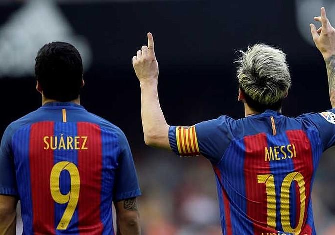 Messi y Suárez comandan la tabla de goleadores de la Liga Española
