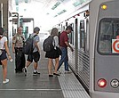 Airport passengers and commuters board a Metrorail car at Miami International Airport on March 25, 2016