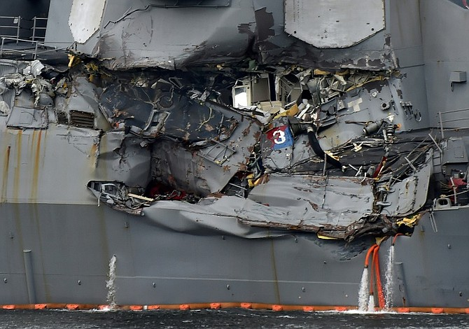 Bodies of 7 missing US Navy sailors found after collision with freighter