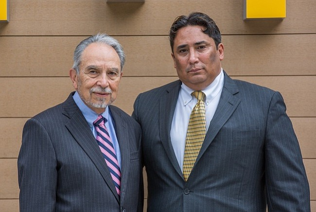 """Joseph Montoya, y su hijo JJ Montoya. """"Puedo decir que no es nada facil, es un trabajo duro"""" - confiesa Joseph Montoya - """"pero me siento orgulloso de representar a la comunidad."""""""