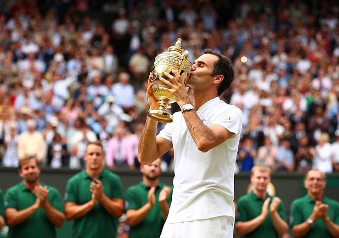 Federer ganó Wimbledon ante un Cilic lesionado