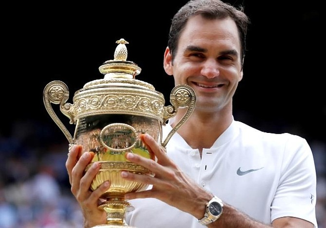 Federer thrashes Cilic in straight sets, wins 8th Wimbledon title