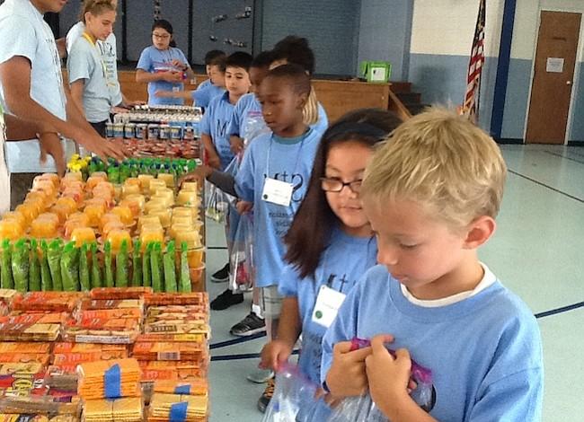 Virginia - Niños preparán comidas para menores necesitados