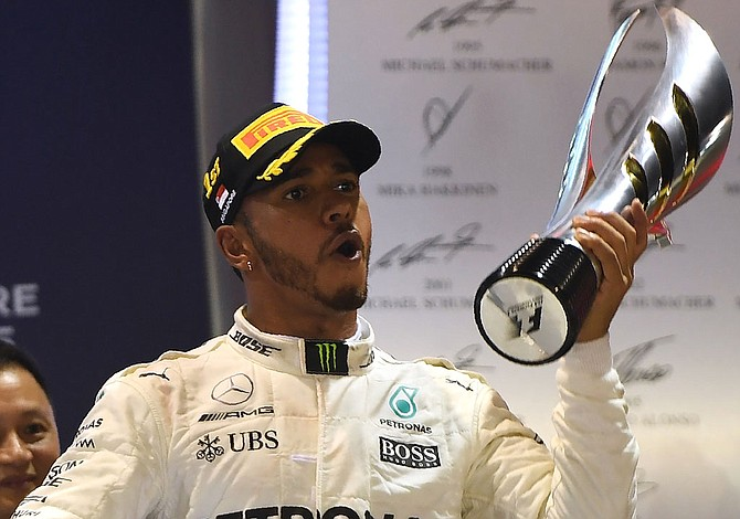Hamilton wins Singapore Grand Prix, maintains lead