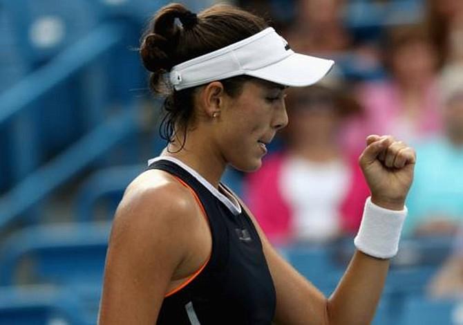 Muguruza says topping WTA ranking makes her calmer