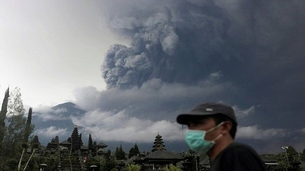 100,000 evacuated, airport closed as Indonesian volcano spews ash, lava