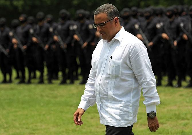 Tribunal condena a Funes y a su hijo por corrupción