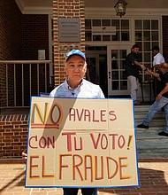 """""""Tiene que haber un cambio total y una apertura hacia los venezolanos -votantes- en el exterior"""". Carlos Madrid, manifestante."""