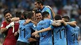 RUSIA. La selección de Uruguay celebrando tras la victoria contra Portugal