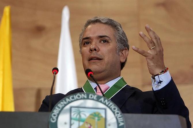 COLOMBIA. El presidente electo de Colombia, Iván Duque, habla luego de recibir una condecoración el martes 10 de julio de 2018 en Medellín, Antioquia