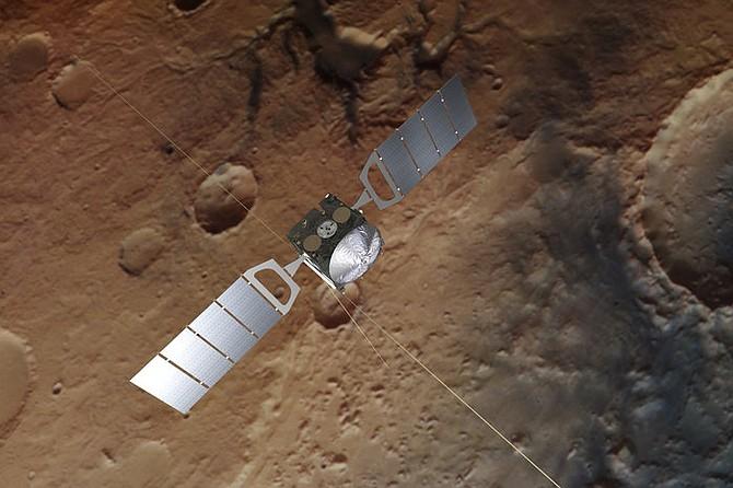 CIENCIA. Representación de la sonda Mars Express. El fondo se basa en una imagen real de Marte tomada por la cámara estéreo de alta resolución de la nave espacial