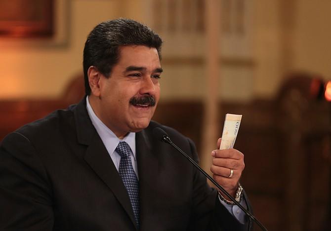 CARACAS. Fotografía cedida por la Oficina de Prensa de Miraflores, de Nicolás Maduro durante unas declaraciones el viernes 17 de agosto de 2018, tres días antes de la reconversión