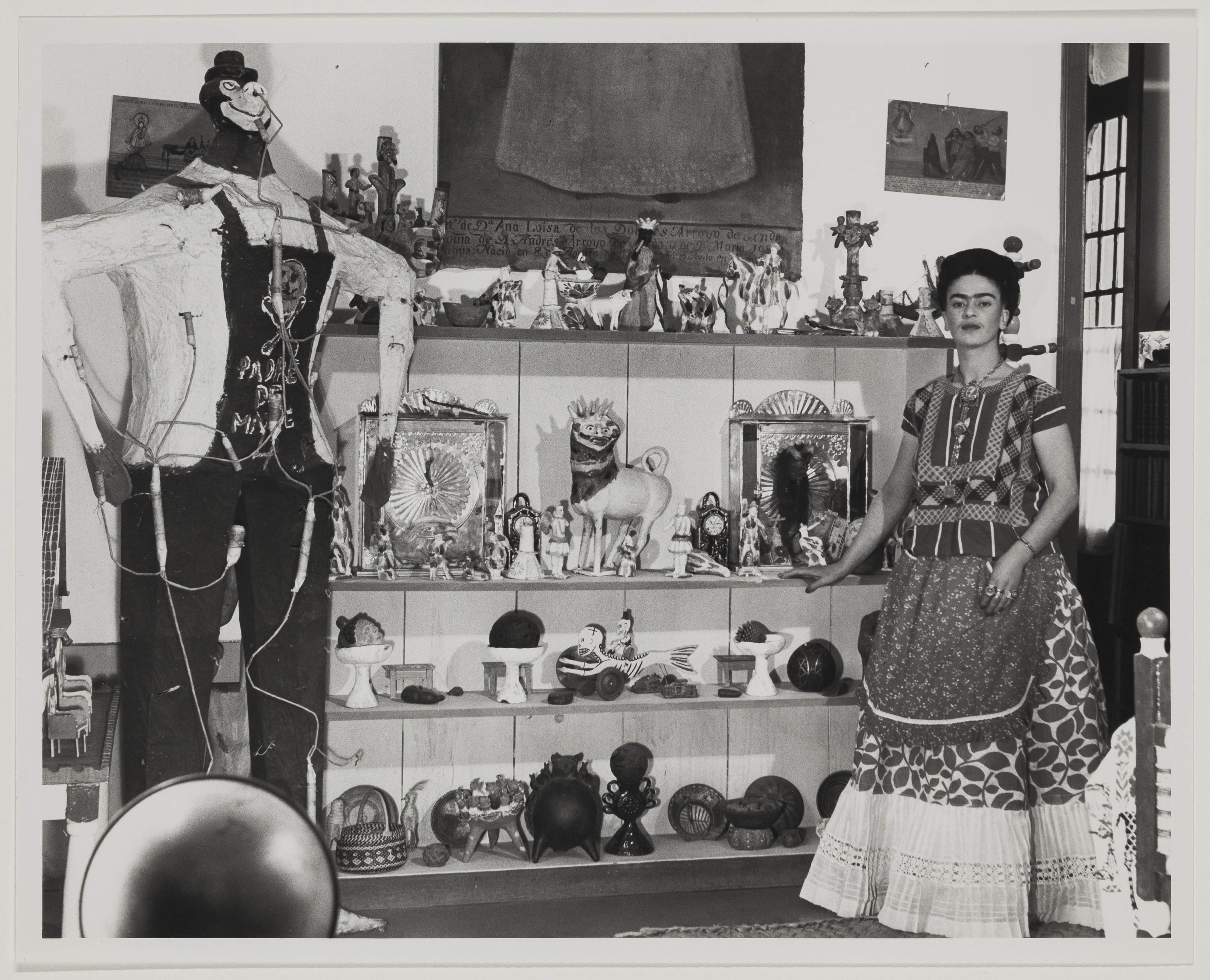 Frida Kahlo in Rivera Living Room with Figure of Judas Bernard Silberstein (American, 1905–1999)