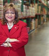 COMUNIDAD. La puertorriqueña Elda Devarie, dueña de la distribuidora EMD Sales es conocida por su trabajo caritativo.