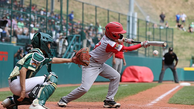 Una acción de encuentro entre Japón y Corea del Sur, disputado este miércoles en Williamsport (Foto Cortesía de Little League World Series)